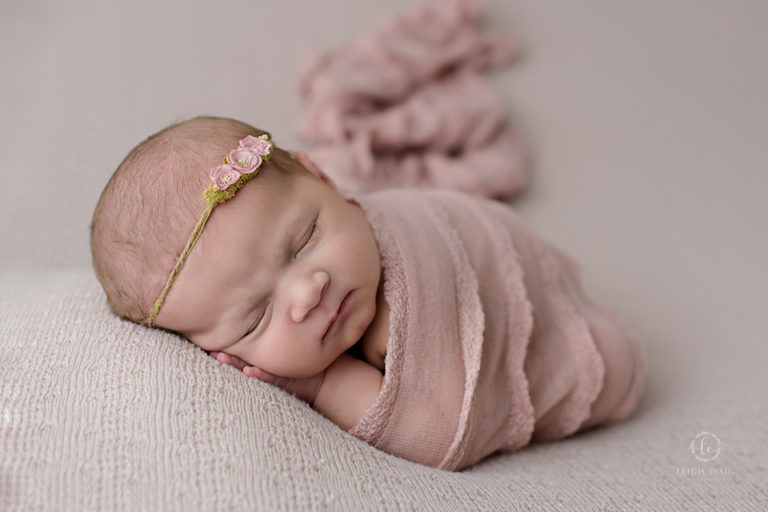 baby girl in pink wrap