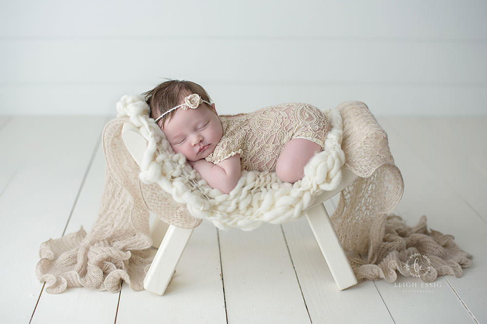 baby girl in curved bench