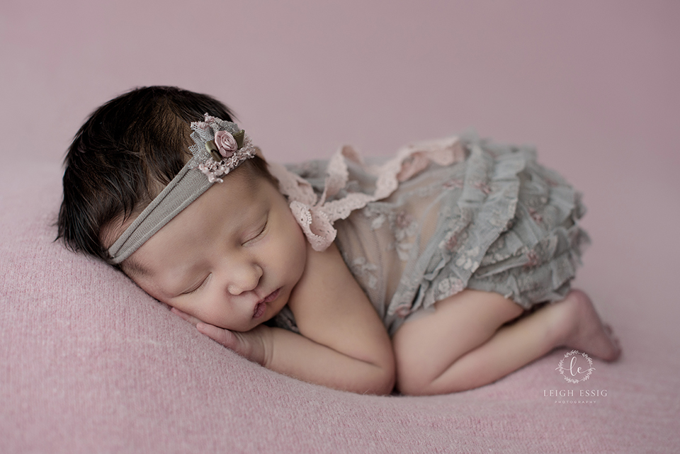 baby girl in gray lace outfit and headband