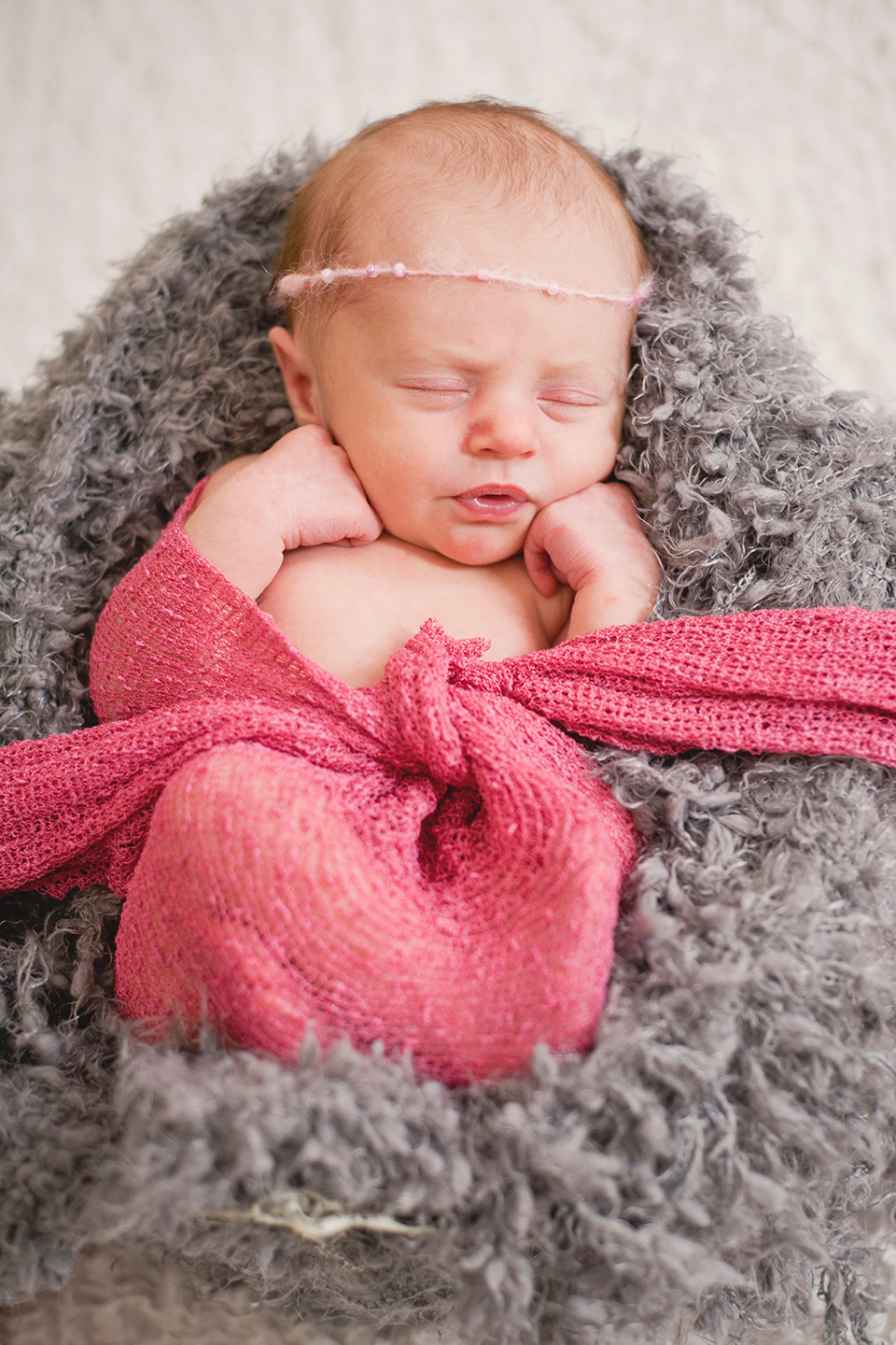 Baby girl with beaded headband in gray and pink
