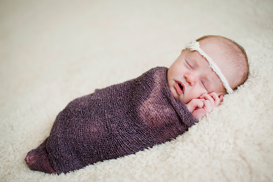 Baby girl in purple wrap and cream lace headband